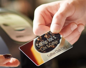 Customer Being Handed a Coffee Shop Loyalty Card